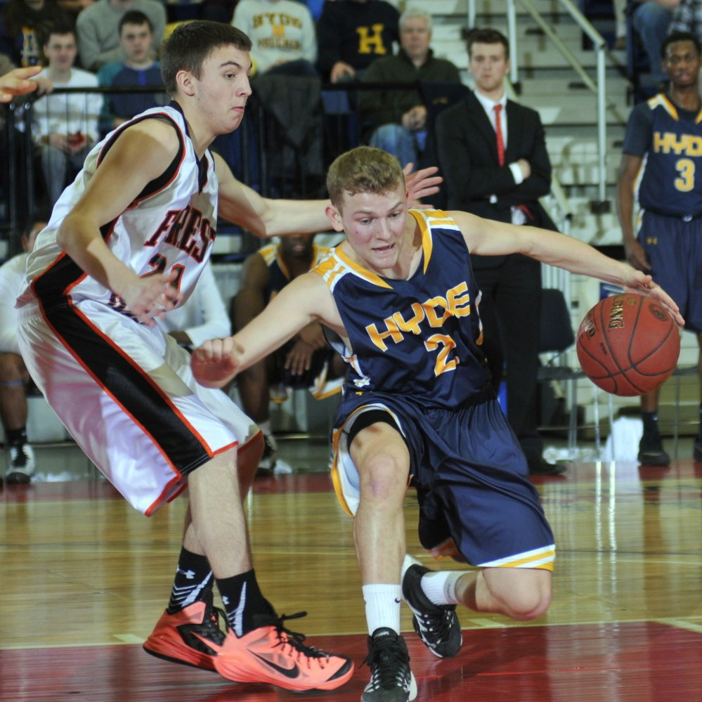 Hyde senior guard Keifer Cundy tries to dribble past Aaron Moffitt of Forest Hills, which beat the Phoenix to remain unbeaten and advance to the Class D state championship game.
