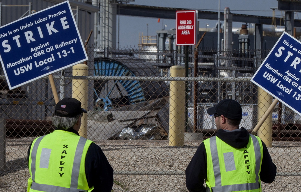 Workers picket at Marathon Petroleum's Galveston Bay refinery in Texas City this month.
