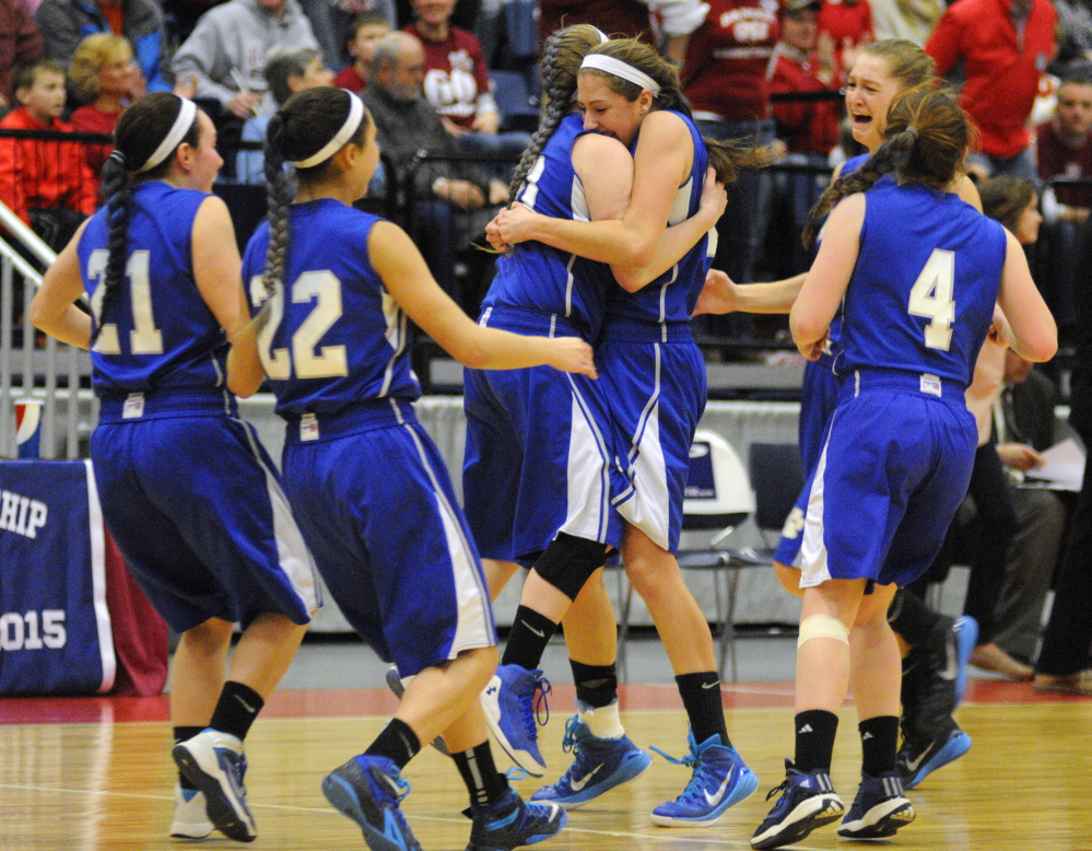Lawrence players celebrate after a 46-42 win over Bangor in the Eastern Class A girls' basketball championship game Saturday at the Augusta Civic Center.