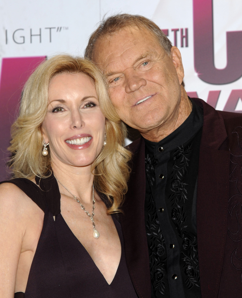 Glen Campell is shown with his wife, Kim, in 2011, when he toured the world despite early Alzheimer's.