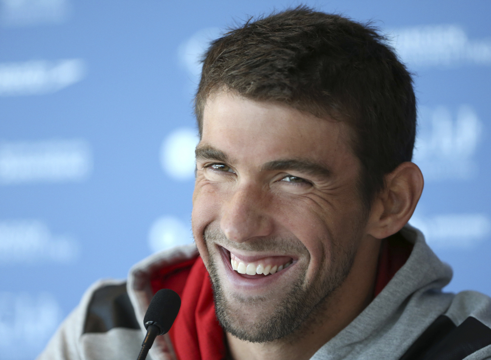 U.S. swimmer Michael Phelps announced on Twitter he's marrying Nicole Johnson, who was Miss California in 2010 and has dated Phelps on and off the past few years.