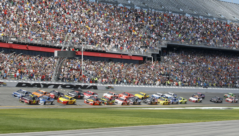 Jeff Gordon, bottom left, and Jimmie Johnson, top left, lead the field at the start of the Daytona 500 NASCAR Sprint Cup series auto race at Daytona International Speedway, Sunday, in Daytona Beach, Fla.
