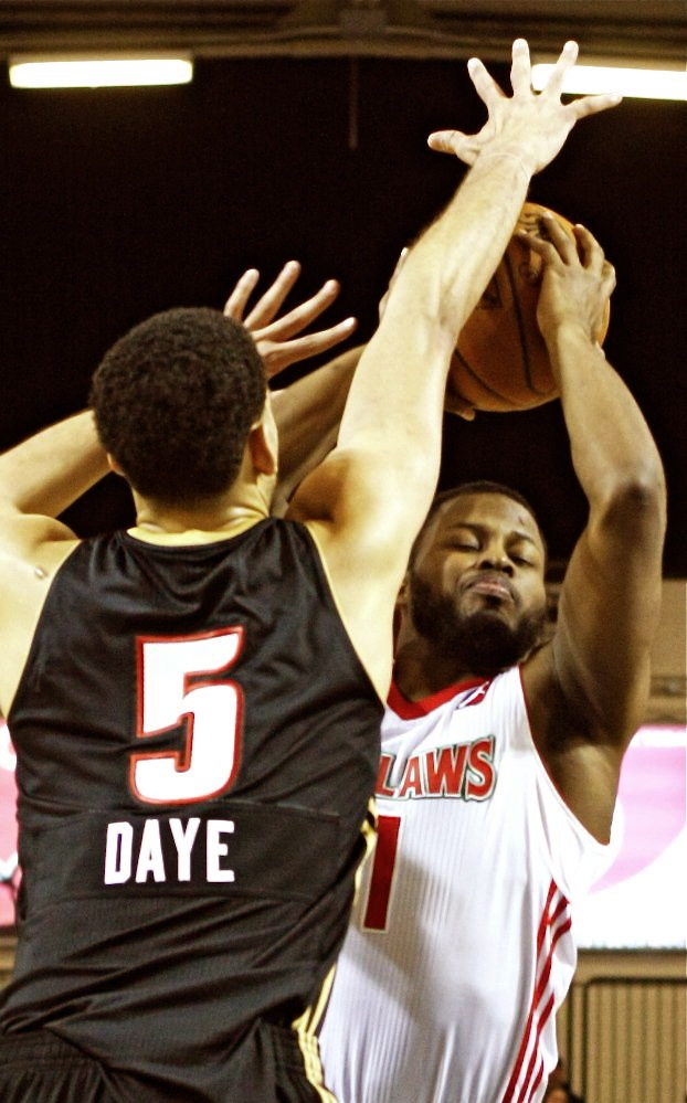 Red Claws' Andre Stringer goes up for a shot while being defended by Erie's Austin Daye during the Red Claws' 120-92 win Sunday at the Portland Expo. Stringer scored 19 points.