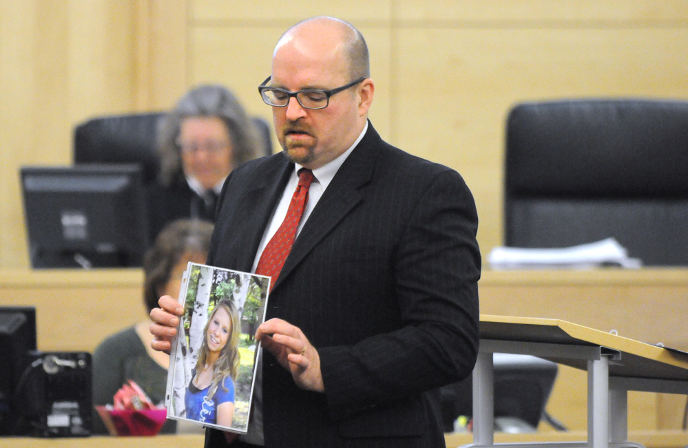 Assistant Attorney General Donald Macomber holds up a picture of Nichole Cable during opening arguments on the first day of Kyle Dube's trial at the Penobscot Judicial Center in Bangor on Monday.