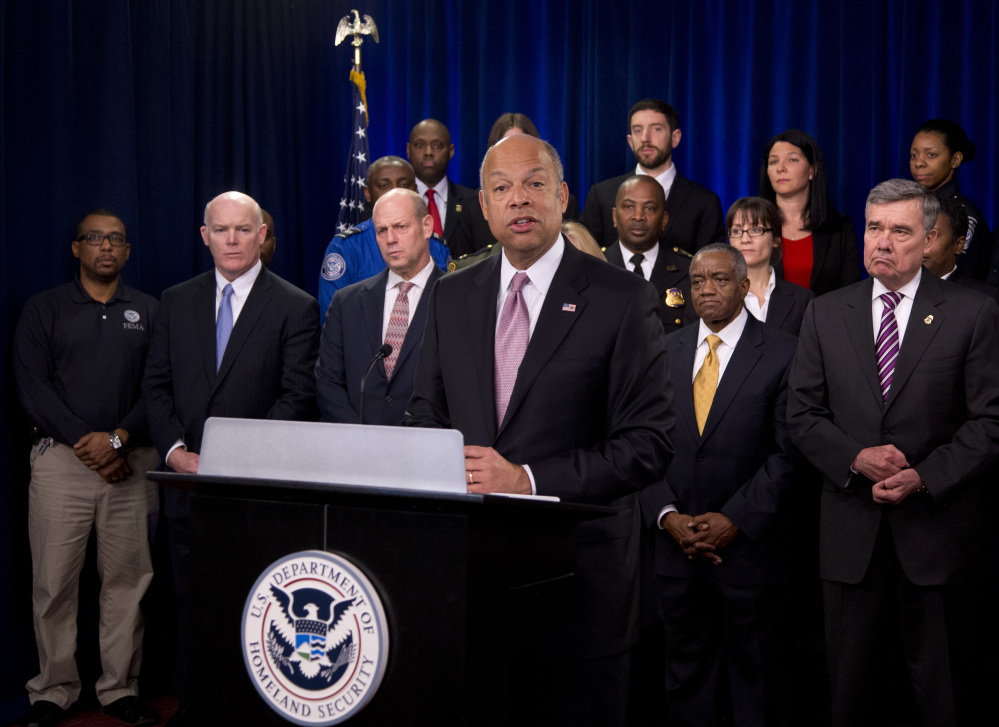 Homeland Security Secretary Jeh Johnson, joined by the department employees, speaks during a news conference in Washington on Monday to discuss the need for Congress to pass a full-year appropriations bill.