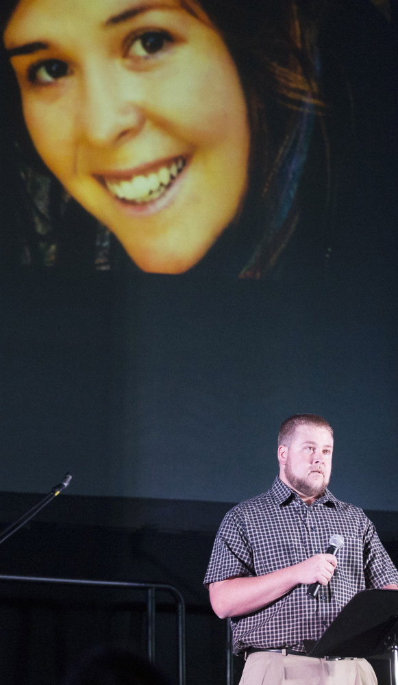 Eric Mueller talks about his sister, Kayla Mueller, during a candlelight memorial in Prescott, Ariz., last week. Mueller's family says the government valued policy more than their family.