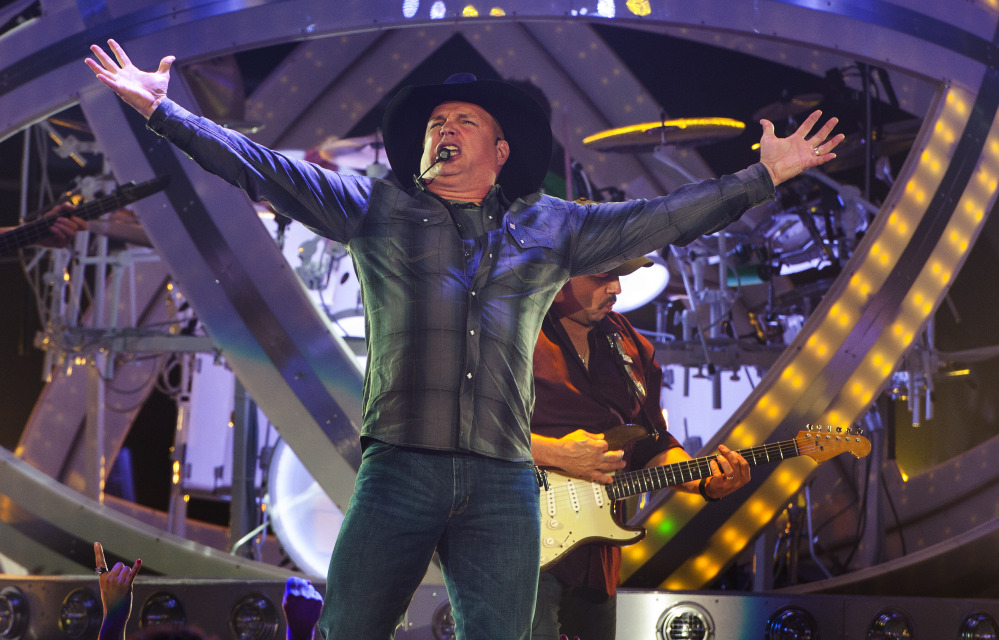 Country music star Garth Brooks kicks off his Garth Brooks World Tour at the Allstate Arena on Sept. 4, 2014, in Rosemont, Ill.