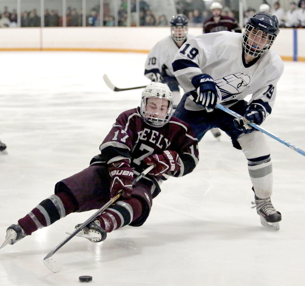 Greely's Dylan Fried tries to control the puck in front of Yarmouth's Matt Madrid as he slips and falls to the ice. Greely finished 3-15-1 this season, but was able to hang in with the second-seeded Clippers.