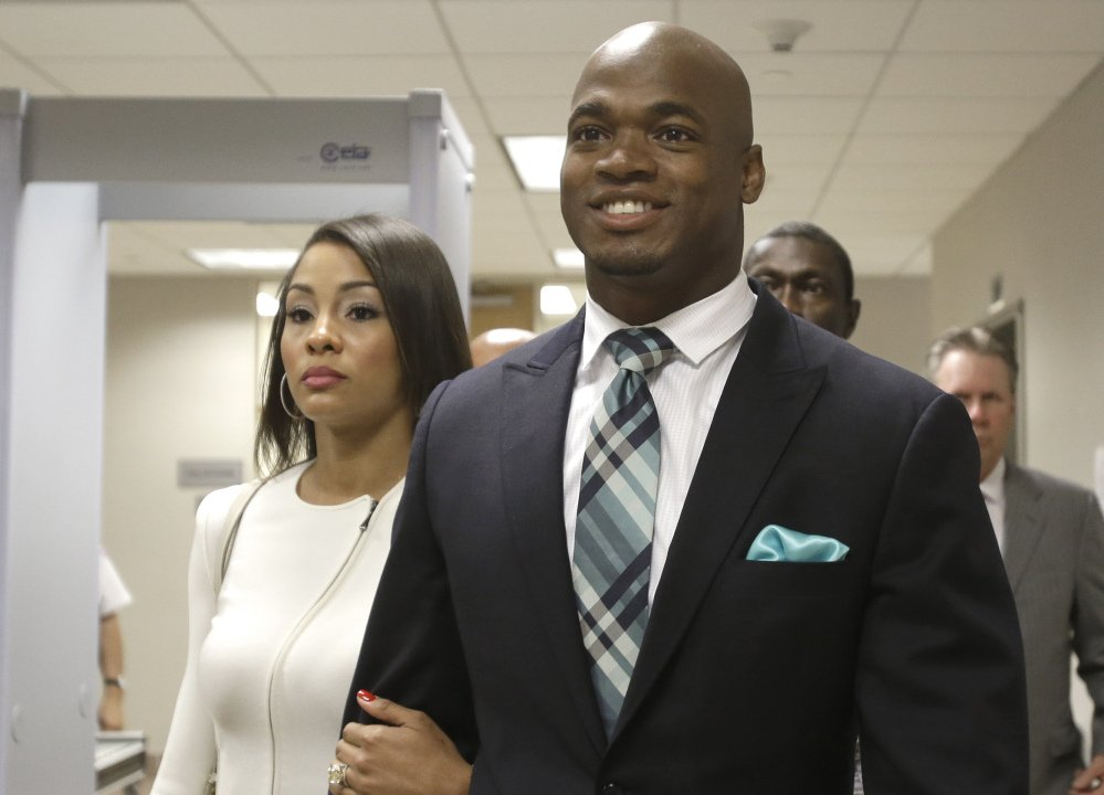 Minnesota Vikings running back Adrian Peterson, seen with his wife, Ashley Brown Peterson, could be reinstated sooner than mid-April because of a judge's ruling Thursday.