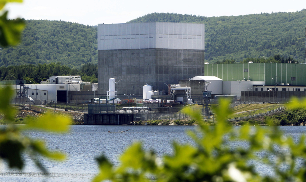 The Vermont Yankee Nuclear Power Station sits along the banks of the Connecticut River in Vernon, Vt.  Mike Twomey, vice president of Entergy Corp., the plant's owner, said Wednesday the company expects to have enough money to finish dismantling it within the required 60-year period.