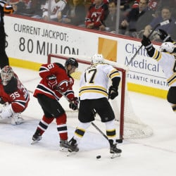 Bruins defenseman Torey Krug, right, celebrates the game-winning goal by teammate Ryan Spooner, not pictured, against Devils goalie Cory Schneider in overtime Friday night in Newark, N.J. The Bruins won, 3-2, after giving up a third-period lead.