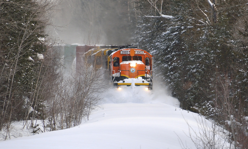 Train 202 of the Central Maine & Quebec Railway forges through snow-covered tracks in Orneville Township – a typical scene for a very unusual winter in New England.