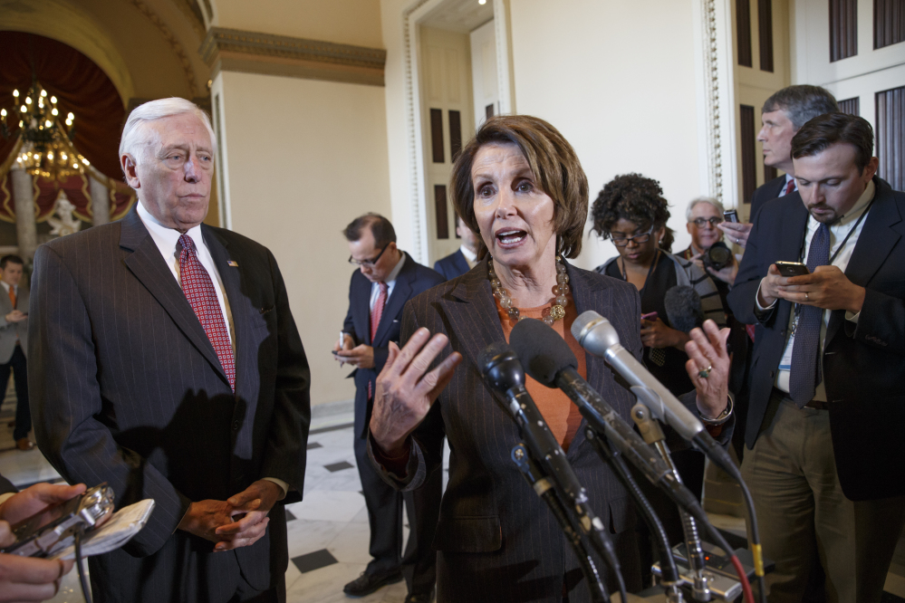 House Minority Leader Nancy Pelosi of Calif., accompanied by House Minority Whip Steny Hoyer of Md., gestures during a news conference on Capitol Hill in Washington on Friday to voice their objections to the Republican majority during a delay in voting for a short-term spending bill for the Homeland Security Department that would avert a partial agency shutdown hours before it was to begin.