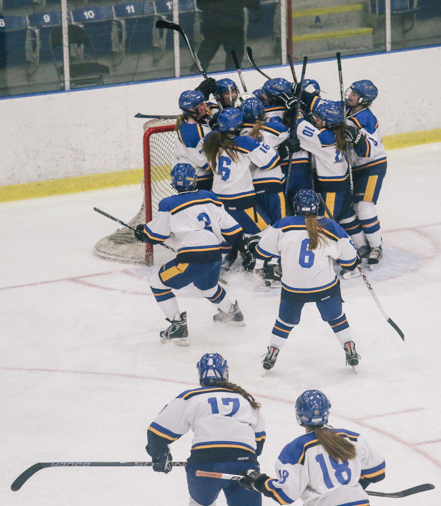 Falmouth celebrates its Western Maine championship Wednesday after closing out a 4-2 win over Scarborough.