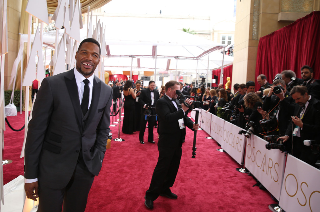 Michael Strahan arrives at the Oscars on Sunday. The Associated Press