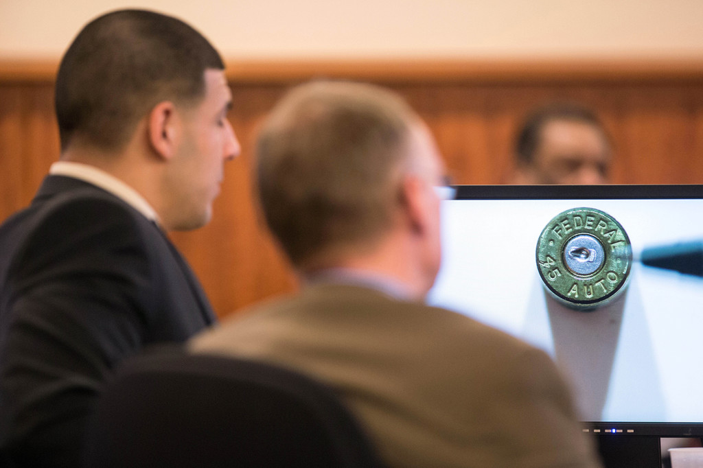 A bullet casing found at the murder scene is displayed as evidence in front of former New England Patriots football player Aaron Hernandez during his murder trial at Bristol County Superior Court in Fall River, Mass., on Wednesday. Hernandez is accused of killing Odin Lloyd in June 2013.  The Associated Press