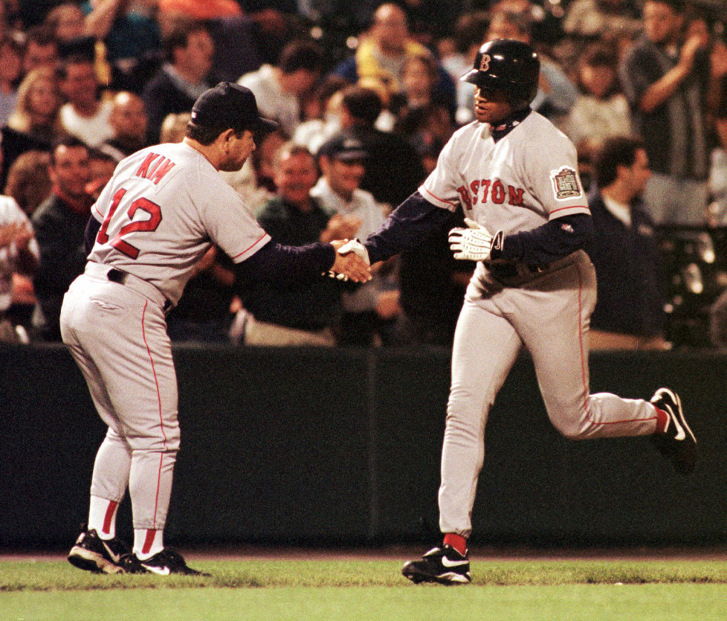 Red Sox third base coach Wendell Kim congratulates Damon Buford after he hit a grand slam in a 1999 game against the Baltimore Orioles. The Associated Press/File photo