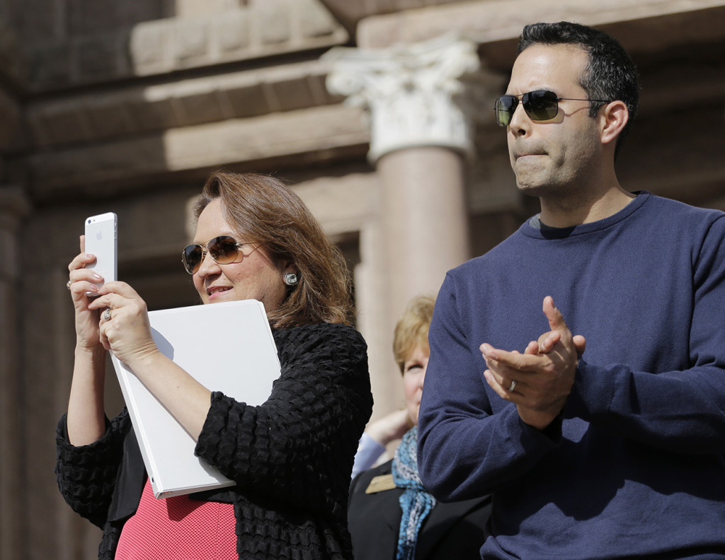 Cecelia Abbott, wife of Texas Gov. Greg Abbott,  left, and George P. Bush take part in the Texas Rally for Life in this 2015 file photo. Bush has endorsed Republican presidential candidate Donald Trump. Associated Press
