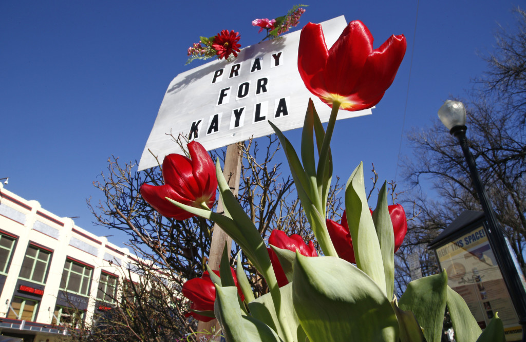 A memorial for Kayla Mueller is seen Tuesday in Prescott, Ariz. Mueller, a 26-year-old American who was held by Islamic State militants, has been confirmed dead, her parents and the Obama administration said Tuesday as the White House prepared to request new war powers from Congress.