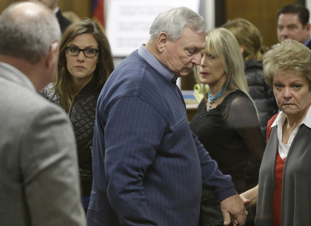 Taya Kyle, left, wife of former Navy SEAL Chris Kyle, follows Don and Judy Littlefield, parents of Chad Littlefield, out of the courtroom after a break in the capital murder trial of Eddie Ray Routh Friday in Stephenville, Texas.  Routh is charged in the 2013 deaths of Kyle and Littlefield at a shooting range near Glen Rose, Texas.