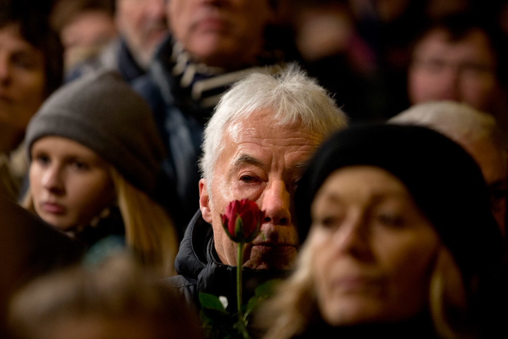 People gather during a  vigil in honor of the two men killed by a gunman over the weekend, at Oesterbro, near the Teater Building 'Krudttonden', the scene of the first attack in Copenhagen, Denmark.