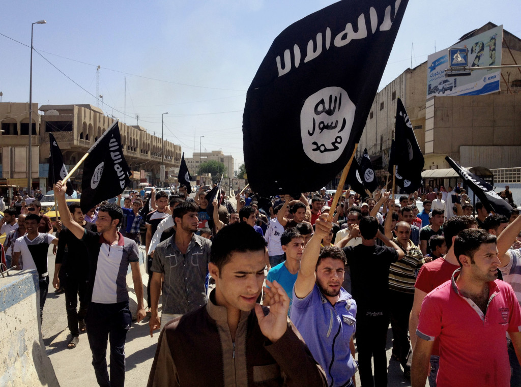 Demonstrators chant pro-Islamic State group slogans as they carry the group's flags in front of the provincial government headquarters in Mosul, Iraq, in June. President Barack Obama ignores the experience of a terror-tossed Europe and the Mideast.