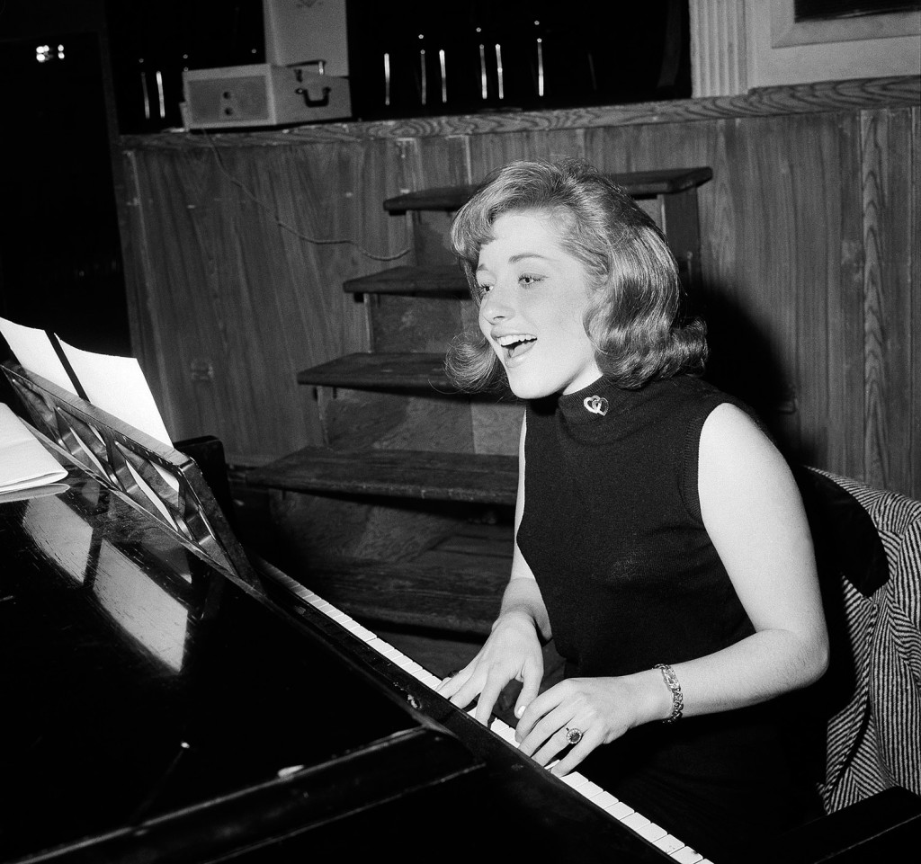 In this 1966 file photo, Lesley Gore rehearses at a piano in New York.  She died of cancer Monday. The Associated Press