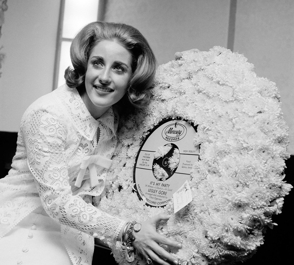 In this 1964 file photo, singer Lesley Gore hugs a flowered record at her 18th birthday party celebrated at the Delmonico Hotel in New York. Gore died of cancer, Monday. She was 68. The Associated Press