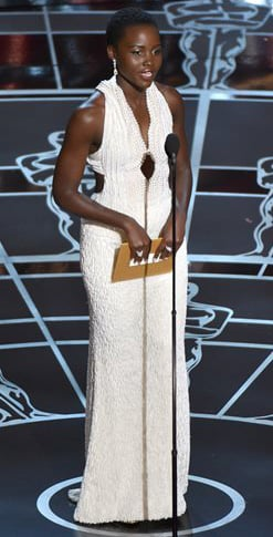 Actress Lupita Nyong'o wears a pearl dress as she presents an award at the Oscars in Los Angeles on Sunday. Los Angeles sheriff's detectives are investigating the theft of the dress, valued at $150,000. The Associated Press
