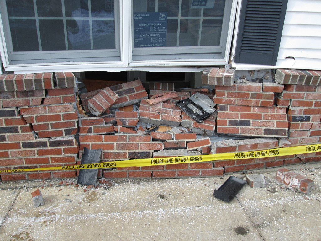 Exterior wall of the post office damaged by the truck. Courtesy Yarmouth police