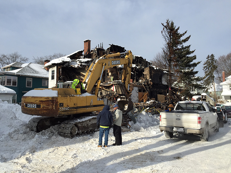 The scene on Noyes Street in Portland on Friday morning as crews demolished the fire-gutted house.
