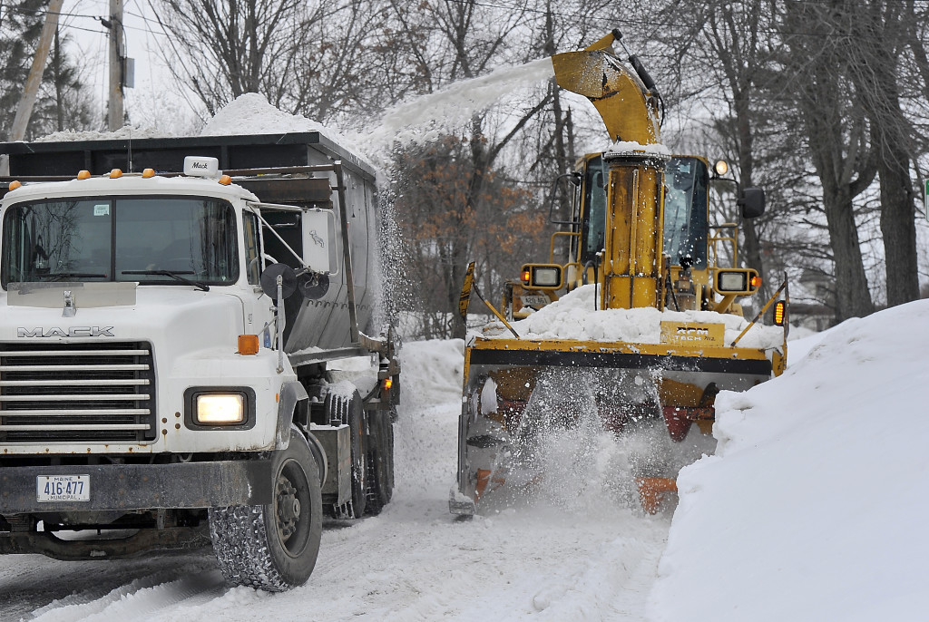 Portland City Services crews remove the heavy accumulation of snowbanks on Washburn Street Thursday morning.