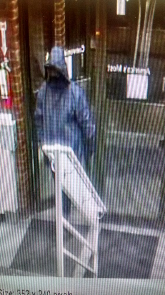 A security camera captured this photograph of the man police say robbed the TD Bank on Main Street in downtown Waterville on Thursday. The man wore a black cap and full face mask, and is described as being about 6 feet tall and weighing about 250 pounds.