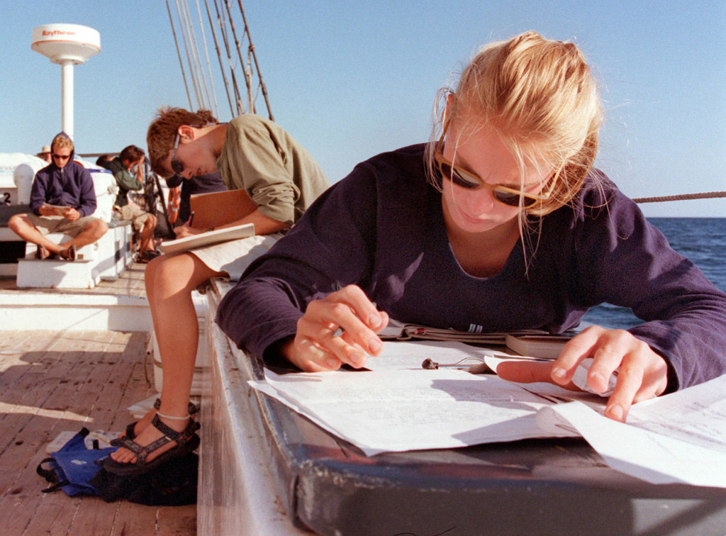 Tracey Mohr of Falmouth does homework aboard the Harvey Gamage as it sails out of Stonington, Connecticut. Students aboard the schooner studied history, science, literature and applied math classes in addition to learning navigation.