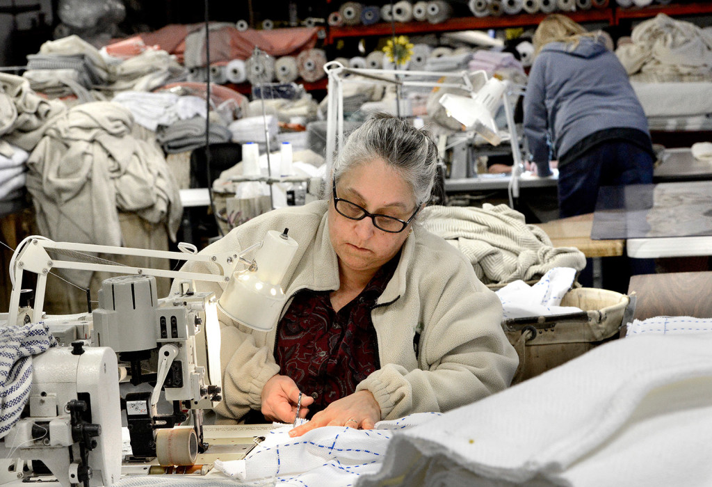 Stitcher Lori Larrabee works on stroller blankets at Brahm's Mount Mill in Monmouth. The company has been making blankets on vintage looms since 1983.
