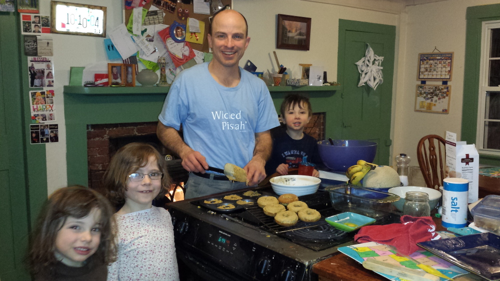 Chris Myers Asch with sous chefs Robin, 5, Miriam, 7, and Aaron, 2. The family lives in Hallowell.