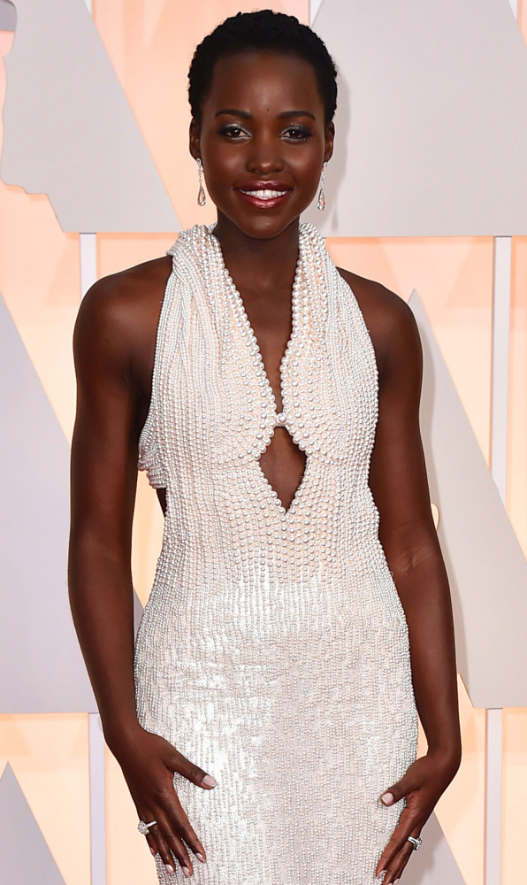 Lupita Nyong'o arrives at the Oscars on Sunday. Her dress, valued at $150,000, was stolen late Wednesday.