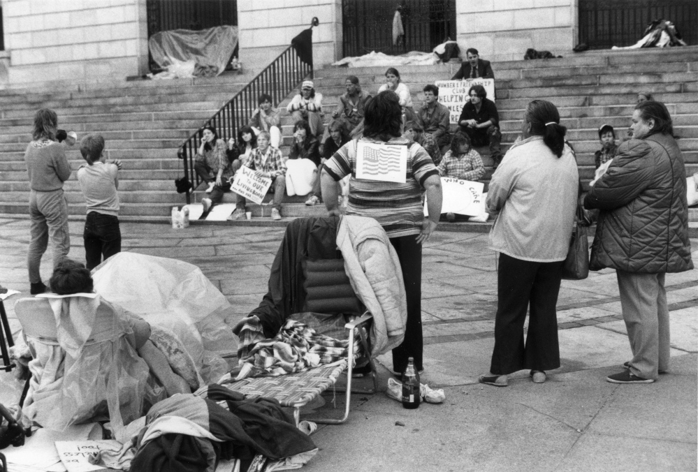 Homeless people camp out on the plaza at Portland City Hall on July 4, 1987, as part of a protest that began July 1. The group eventually moved to nearby Lincoln Park, to protest the closure of a private shelter.