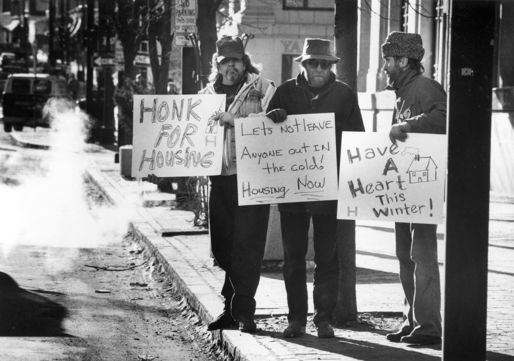 Pete LeClerc, Paul Lichter, and Jeffrey Phillips keep their weekly noontime Wednesday vigil in Portland's Monument Square on Dec. 13, 1989. Throughout the 1980s, the state was reducing the size of its mental health institutions, which effectively put more people with mental illness onto the streets.