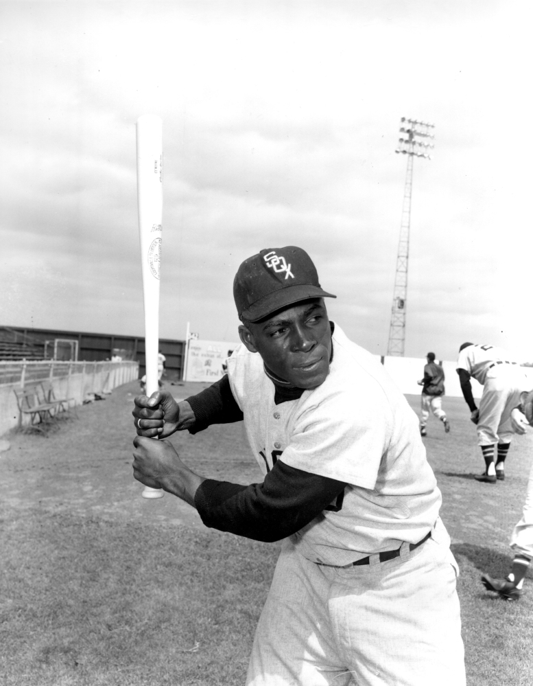 """Chicago White Sox outfielder Orestes """"Minnie"""" Minoso poses in batting position in Tampa, Fla., in March 1957."""