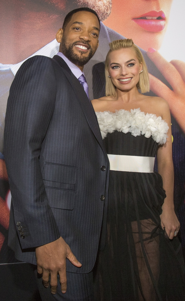 "Will Smith and Margot Robbie are all smiles at the Feb. 24 Hollywood premiere for ""Focus."""