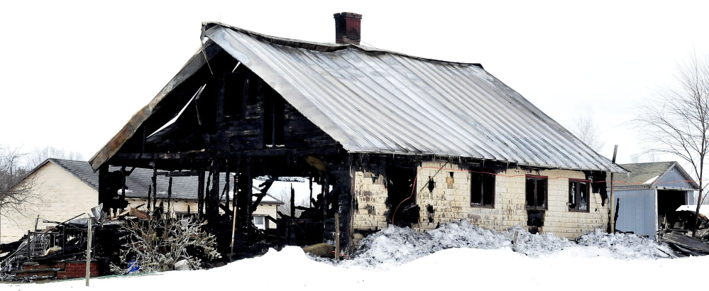 Fire destroyed this old farmhouse on the Weeks Mills Road in New Sharon on Friday night, leaving a family of seven homeless.