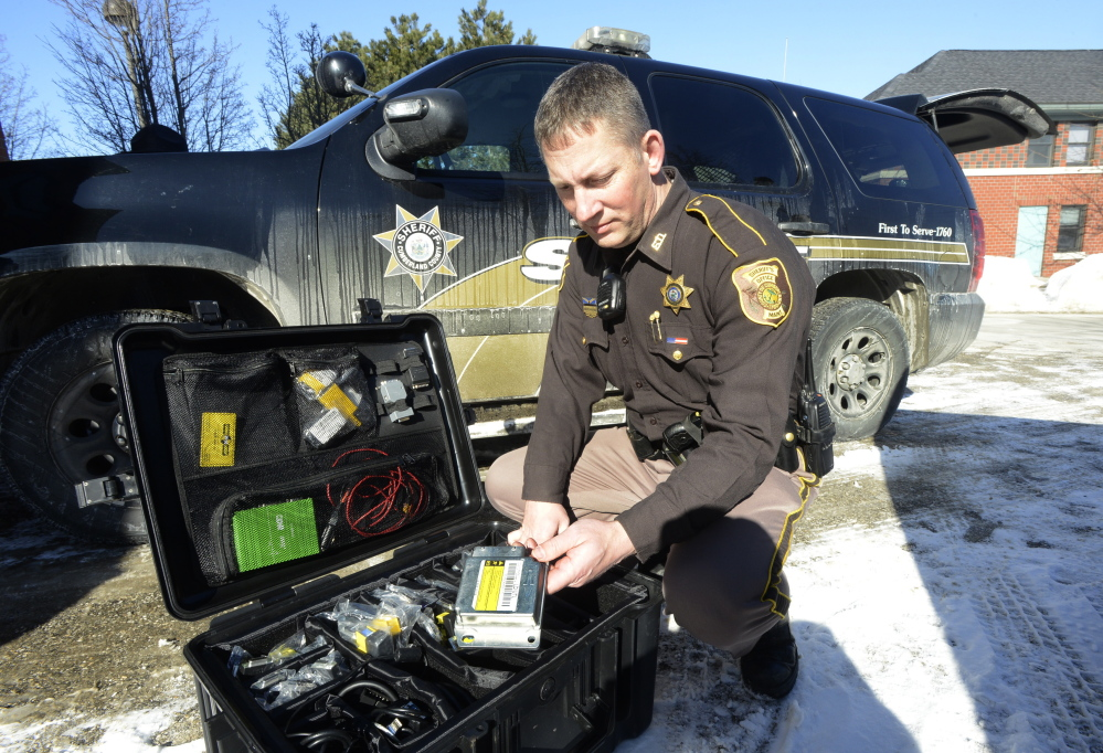 Andrew Hanna, a Cumberland County sheriff's deputy, unpacks his crash assessment tool kit, which holds about $10,000 worth of high-tech  gear.