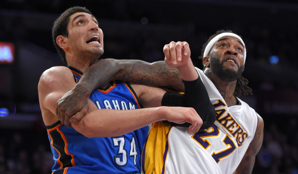 Oklahoma City center Enes Kanter, left, and Lakers center Jordan Hill battle for position during Sunday's game in Los Angeles. The Thunder played without stars Kevin Durant and Russell Westbrook but won 108-101.