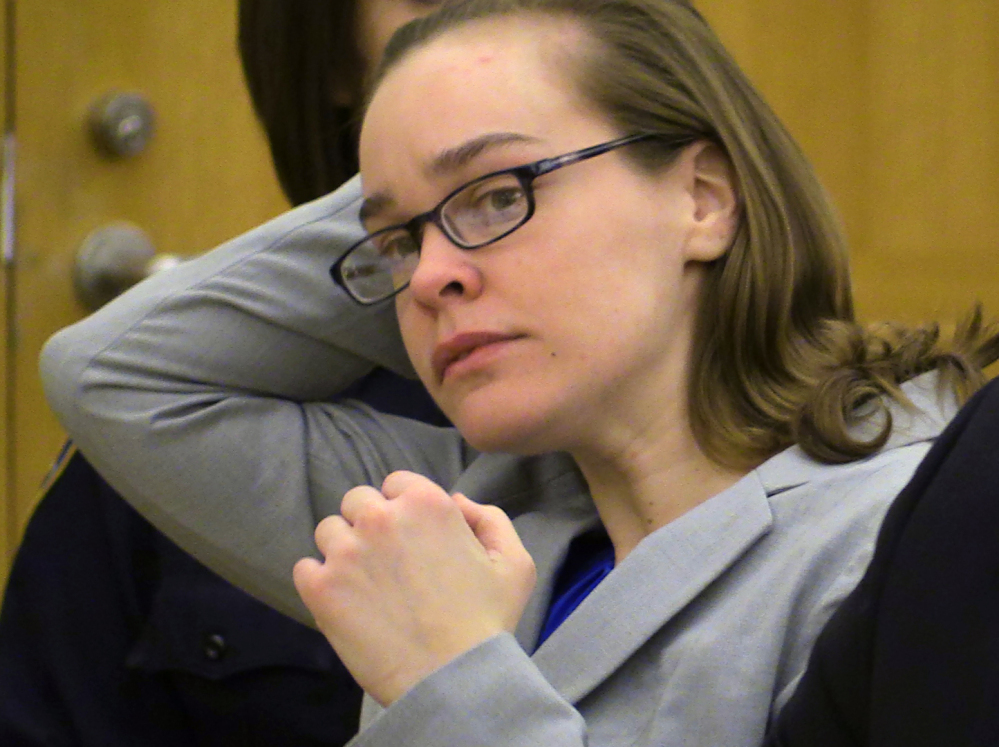 Lacey Spears brushes her hair back during her murder trial last month at the Westchester County Courthouse in White Plains, N.Y. Spears was convicted Monday of poisoning her son, 5-year-old Garnett-Paul Spears, to death.