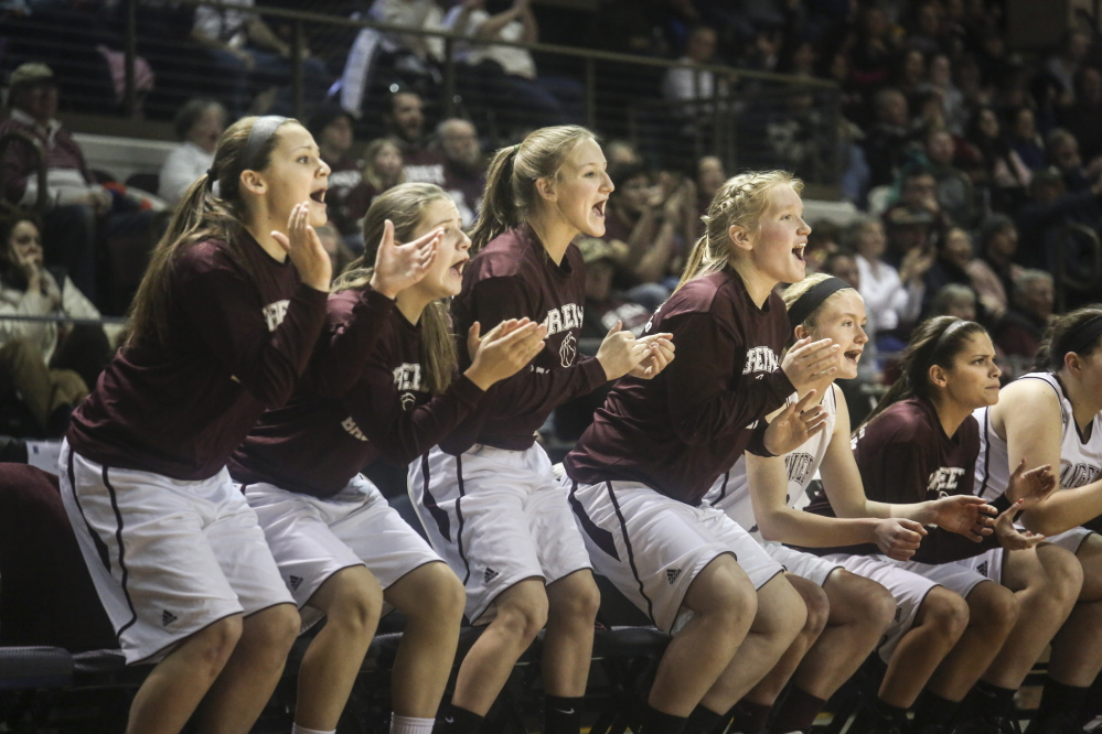 The Greely girls basketball team cheers during the last minutes of the Class B state championship game at the Cross Insurance Arena in Portland on Friday. Whitney Hayward/Staff Photographer