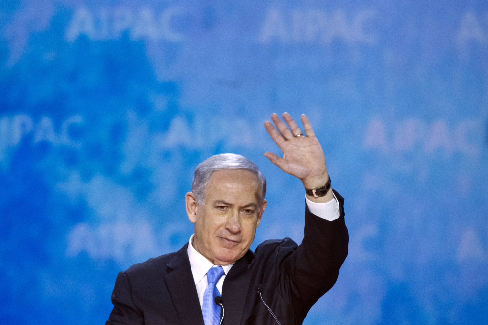 Israeli Prime Minister Benjamin Netanyahu waves at the conclusion of his address to the 2015 American Israel Public Affairs Committee (AIPAC) Policy Conference in Washington, Monday.
