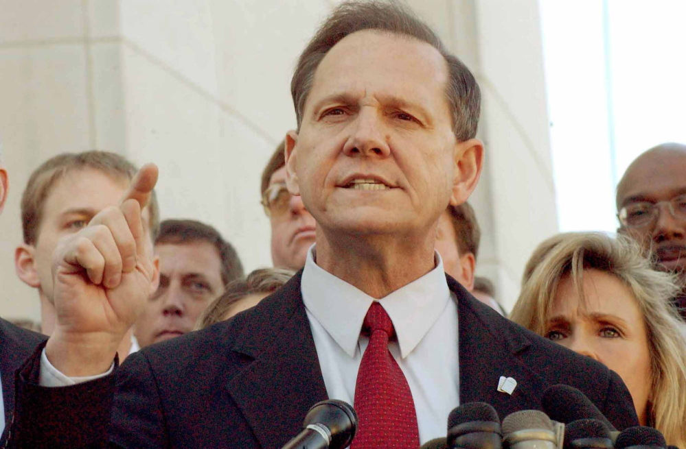 Alabama Chief Justice Roy Moore answers questions from the media.