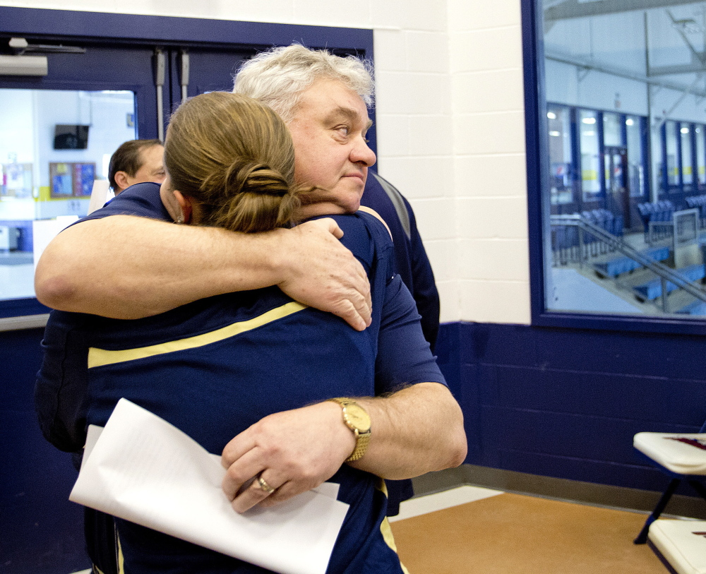 "Gary Fifield hugs assistant coach Rachele Burns after announcing his retirement as USM women's basketball coach Tuesday. 'This was not an easy decision,"" he said."