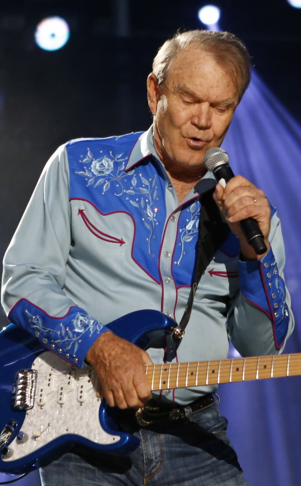 Glen Campbell, seen in healthier days, may be living out his life as the center of a family dispute.